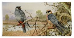 Red-footed Falcons Beach Towel by Carl Donner