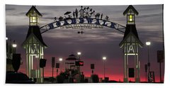 Red Horizon Thru The Boardwalk Arch Beach Towel