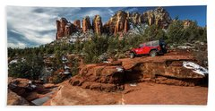 Red Jeep On The Rocks Beach Towel