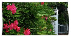 Beach Towel featuring the photograph Red Oleander Arbor by Marie Hicks