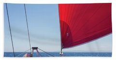 Beach Towel featuring the photograph Red Sail On A Catamaran by Clare Bambers