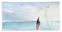 Red Sails On A Blue Sea Beach Towel by Pattie Calfy