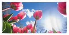 Red Tulips Against Blue Sky Beach Towel