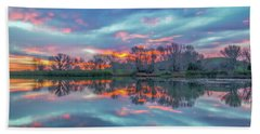 Reflection At Sunrise Beach Towel by Marc Crumpler