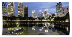 Reflection Of Jakarta Business District Skyline During Blue Hour Beach Towel