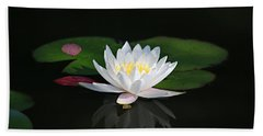 Reflections Of A Water Lily Beach Towel