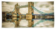 Reflections On Tower Bridge Beach Towel