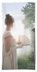 Regency Woman Looking Through A Gateway Beach Towel
