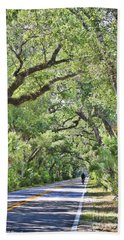 Riding The Ormond Loop Beach Towel by Deborah Benoit