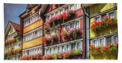 Beach Towel featuring the photograph Row Of Swiss Houses by Hanny Heim