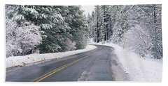 Road Through Snowy Forest, California Beach Towel