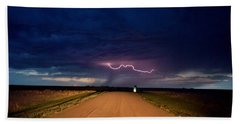 Road Under The Storm Beach Towel by Ed Sweeney
