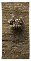 Beach Towel featuring the photograph Rochester, New York - Wall And Flowers Sepia by Frank Romeo