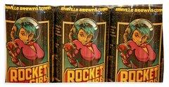 Rocket Girl Beach Towel by Dennis Baswell