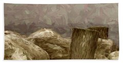 Rocks And Pilings Beach Towel