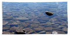 Rocks In Calm Waters Beach Towel