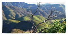 Beach Towel featuring the photograph Rolling Green Hills With Dead Branches by Matt Harang