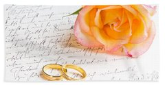 Rose And Two Rings Over Handwritten Letter Beach Towel
