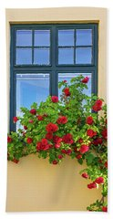 Roses Decorating A House Beach Towel