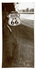 Beach Towel featuring the photograph Route 66 Shield And Fence Sepia Post by Frank Romeo