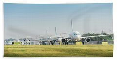 Row Of Airplanes Ready To Take-off Beach Sheet