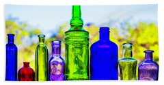 Row Of Colored Bottles Beach Towel