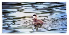 Ruddy Duck Swiimming In A Pond With Autumn Reflections Beach Sheet