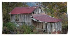 Beach Towel featuring the photograph Rustic Weathered Hillside Barn by John Stephens