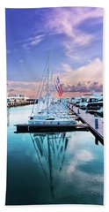 sailboats and yachts in the roads of the main sea channel of the Sochi seaport Beach Towel