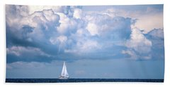 Sailing Under The Clouds Beach Towel