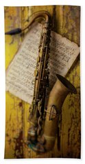 Saxophone Hanging On Old Wall Beach Towel
