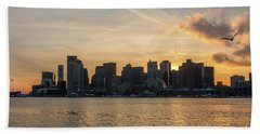 Seagull Flying At Sunset With The Skyline Of Boston On The Backg Beach Towel