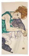 Seated Woman With Legs Drawn Up Beach Towel