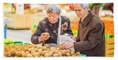 Senior Man And Woman Shopping Fruit Beach Sheet