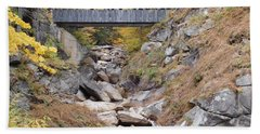 Sentinel Pine Covered Bridge Beach Towel by Catherine Gagne