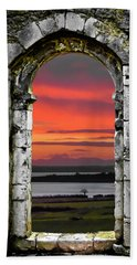 Beach Towel featuring the photograph Shannon Sunrise Through Medieval Arch by James Truett