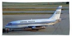 Sierra Pacific Airlines Boeing 737, N703s Beach Towel by Wernher Krutein
