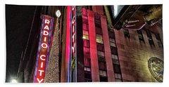 Sights In New York City - Radio City Beach Towel by Walt Foegelle
