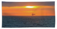 Silhouetted Oil Drilling Platform  Beach Sheet by Allan Levin