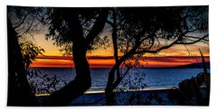 Silhouettes Over Blue Water Beach Towel
