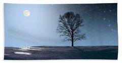 Single Tree In Moonlight Beach Towel by Larry Landolfi