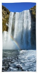 Beach Towel featuring the photograph Skogafoss Waterfall Iceland In Winter by Matthias Hauser