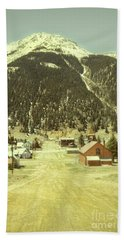 Small Rocky Mountain Town Beach Towel by Jill Battaglia