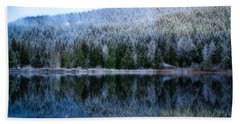 Snow Covered Trees Reflections Beach Towel by Lynn Hopwood
