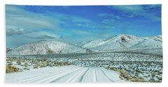 Beach Towel featuring the photograph Snow In Death Valley by Peter Tellone