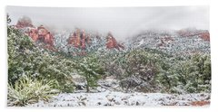 Snow On Red Rock Beach Towel
