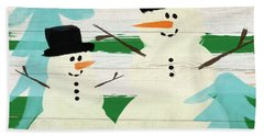 Snowmen With Blue Trees- Art By Linda Woods Beach Towel by Linda Woods