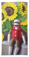 Beach Towel featuring the painting Sock Monkey And Sunflowers by Randol Burns