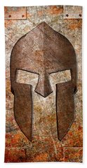 Spartan Helmet On Rusted Riveted Metal Sheet Beach Towel