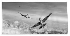 Beach Towel featuring the photograph Spitfire Attacking Heinkel Bomber Black And White Version by Gary Eason